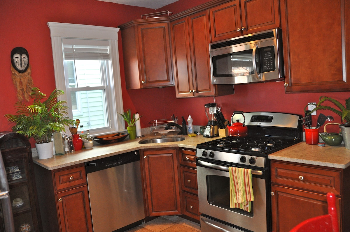 Bright kitchen with dishwasher, microwave, and garbage disposal