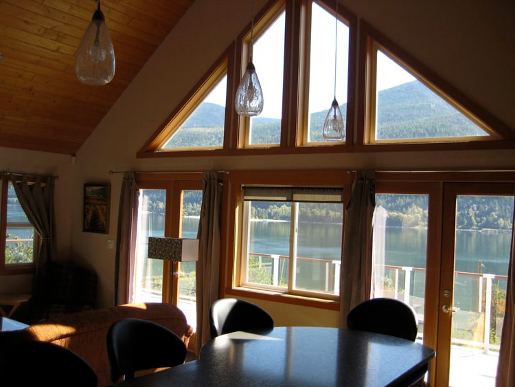 Patio doors to deck with lake view