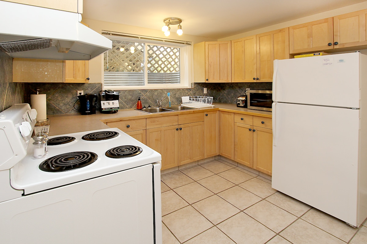 Kitchen with amenities such as coffee/tea, stove, fridge microwave.