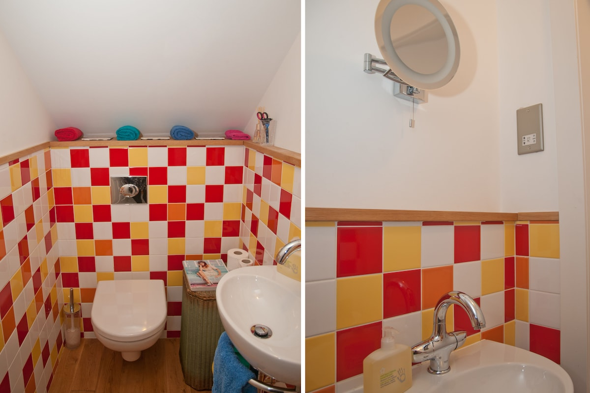 Two views of the upstairs toilet next to the guest bedroom