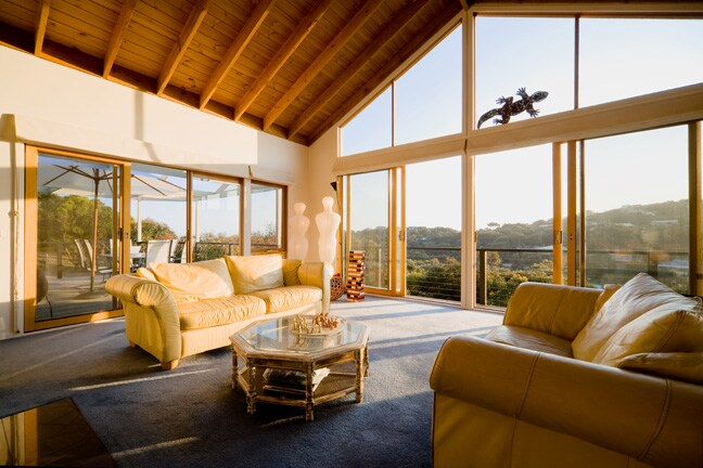 The upstairs main living area, glassed on 3 sides for magnificent views of the valley and State forest beside us.