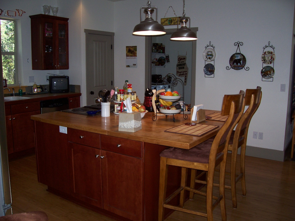 Bamboo kitchen island with breakfast bar for guests.