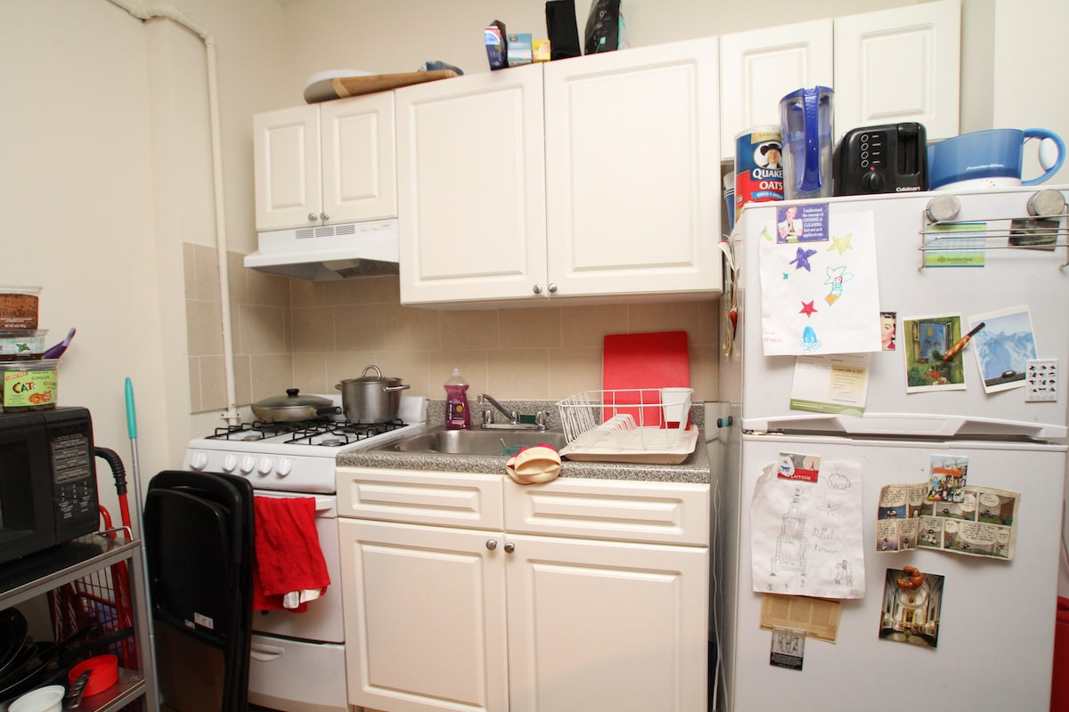Close-up of kitchen--full-sized appliances and gas stove, plus lots of other gadgets you might want.