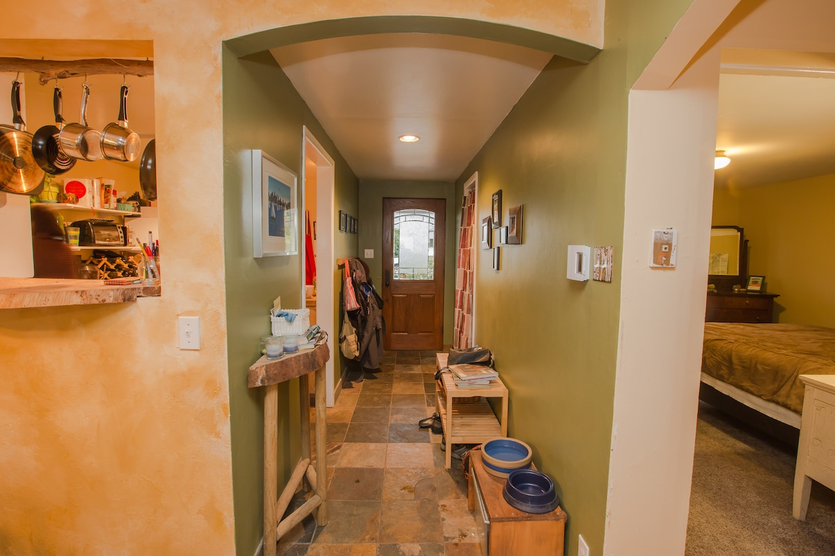 Front entry with slate tile floor, has closet and coat rack to stash wet boots and jackets