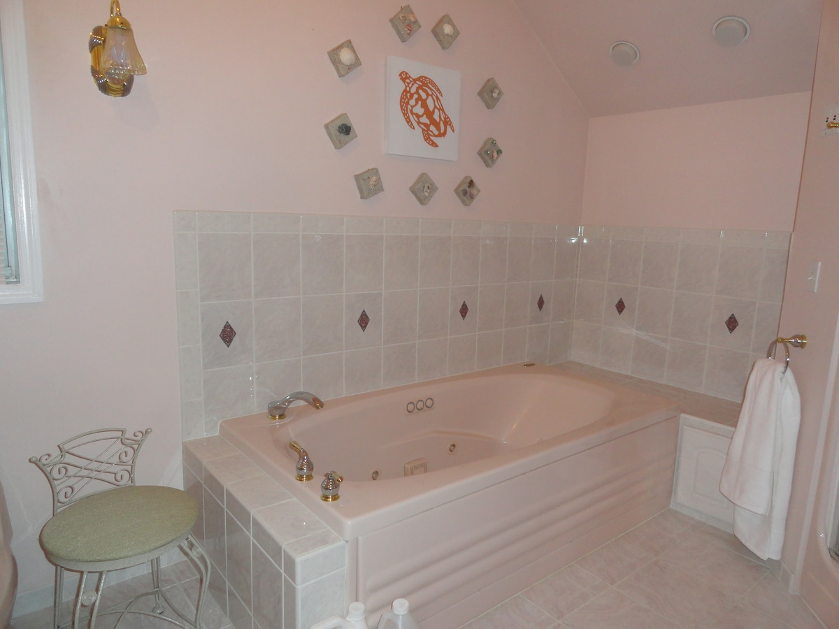 Luxurious over-sized heated Jacuzzi tub with bath salts, tub pillow..