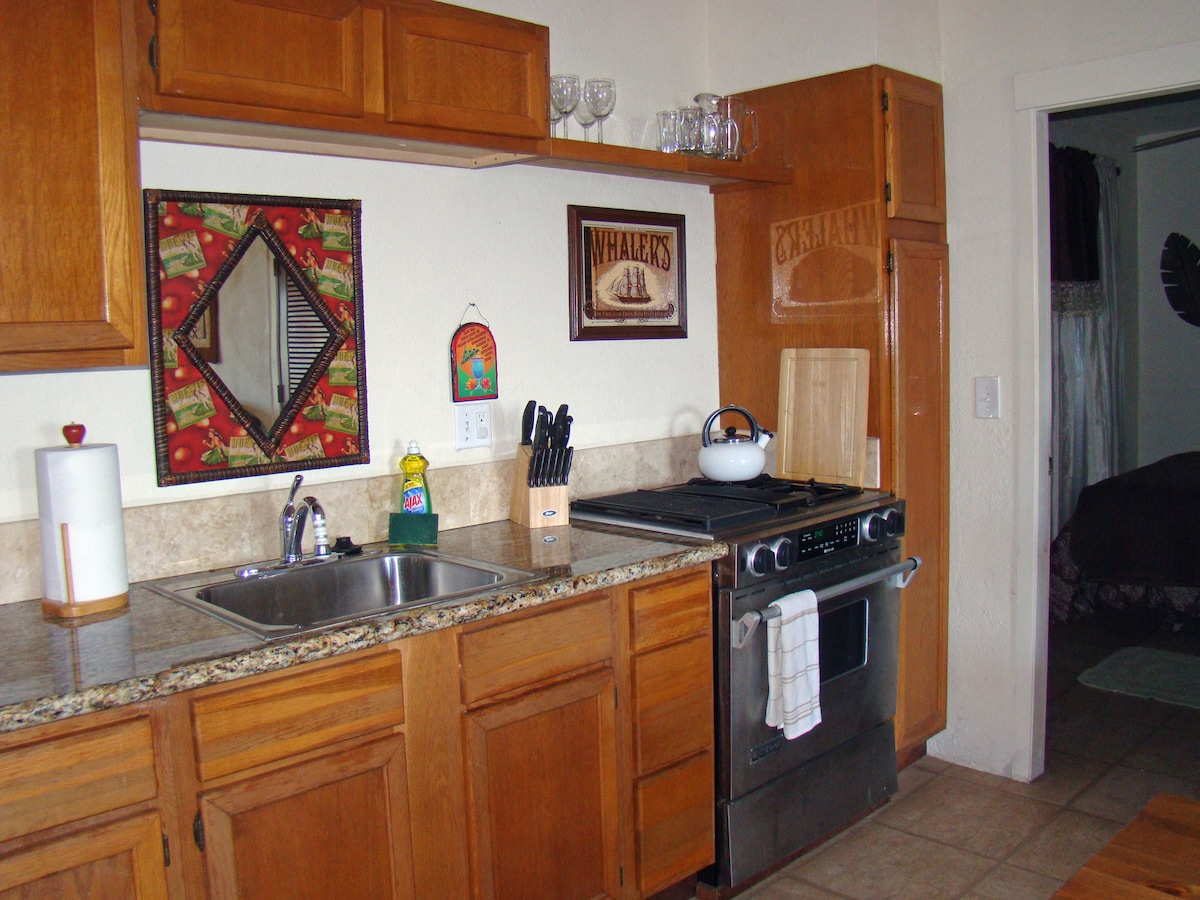 Kitchen has a fully equipped kitchen with granite countertops.