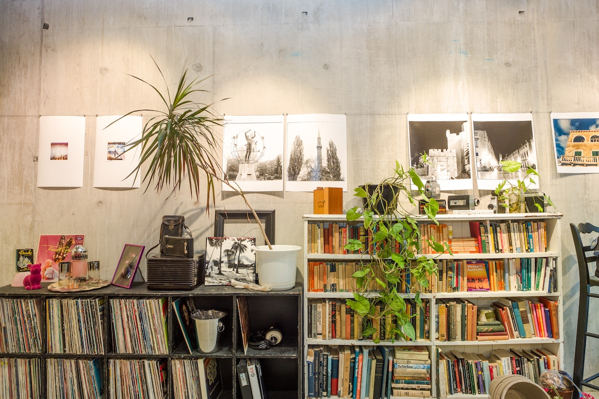 Art, books, and vintage in a creatively chaotic working photography studio and gallery.