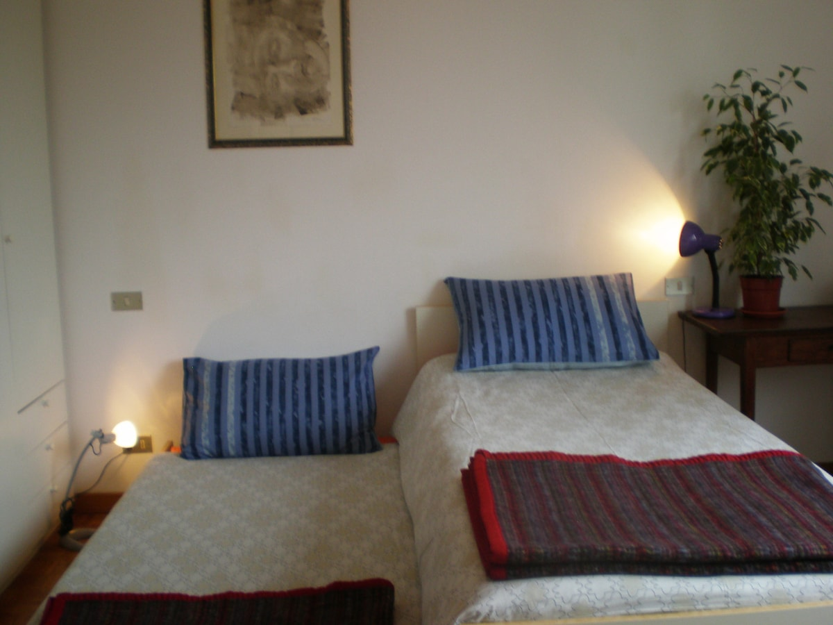 double bed in white room