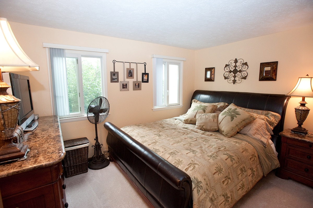 King sized bed in the bedroom with a very comfortable Sterns & Foster mattress