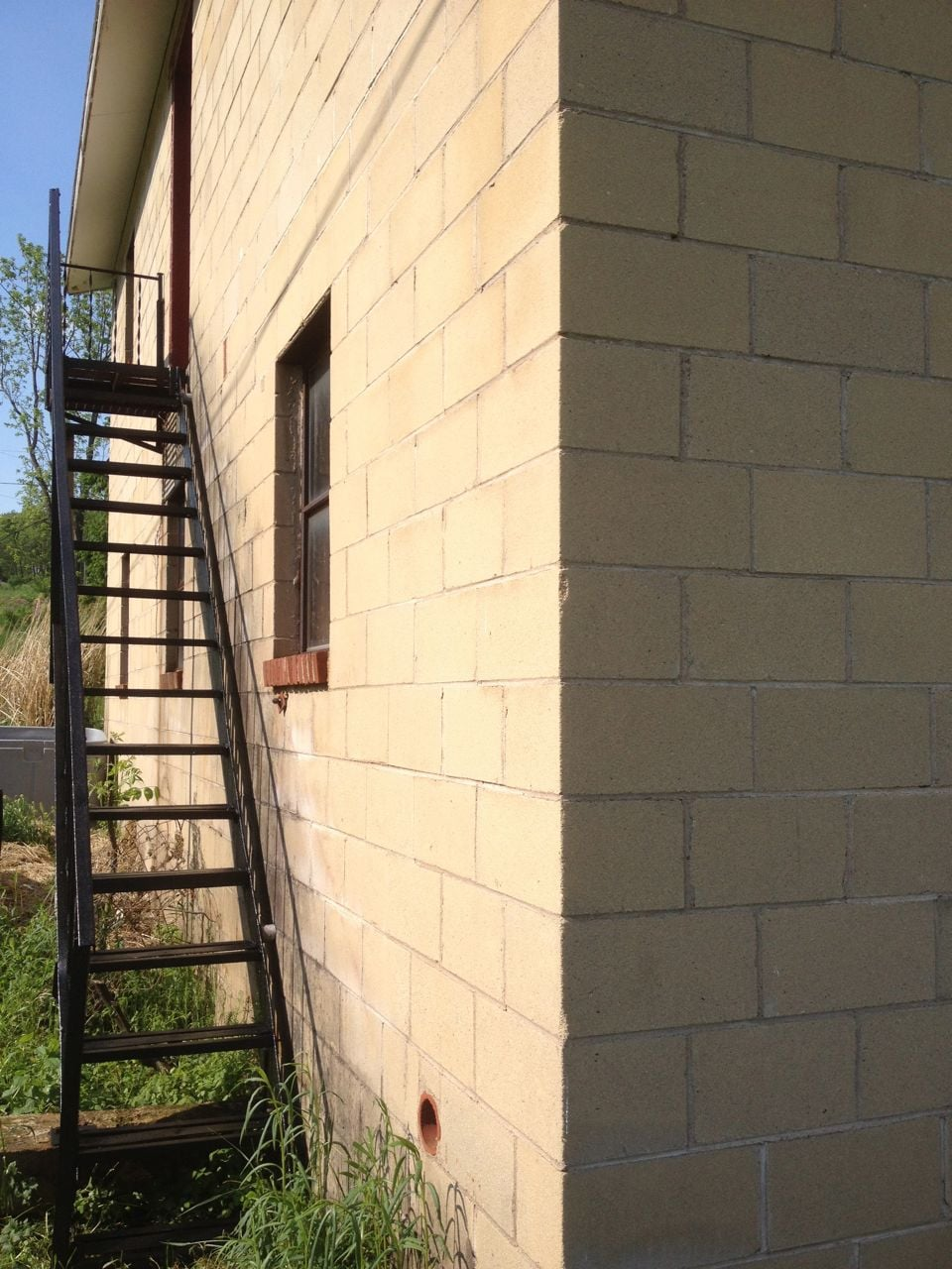 The stairs leading to the guest loft, located on the backside of the brick building.
