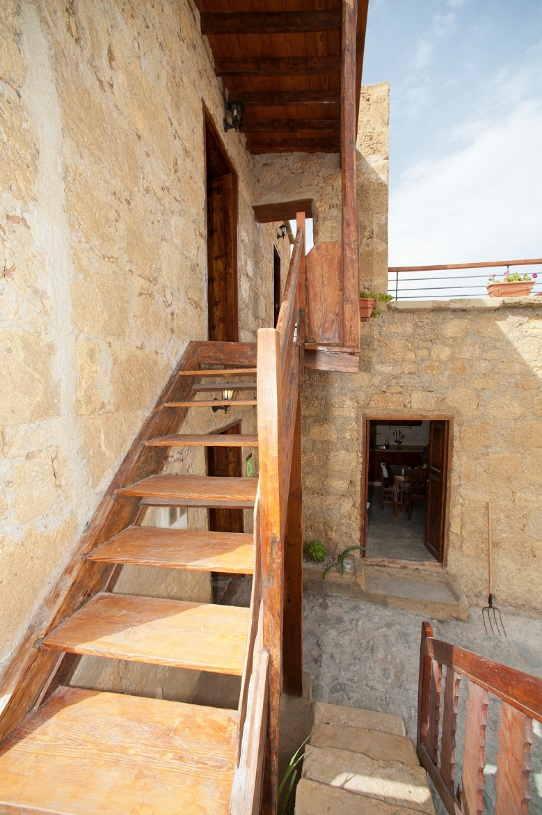 Stairs to the bedrooms and terrace with sea views.