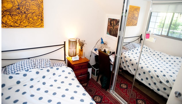 Comfy room with double bed, desk, lamps, in-built shelving and window