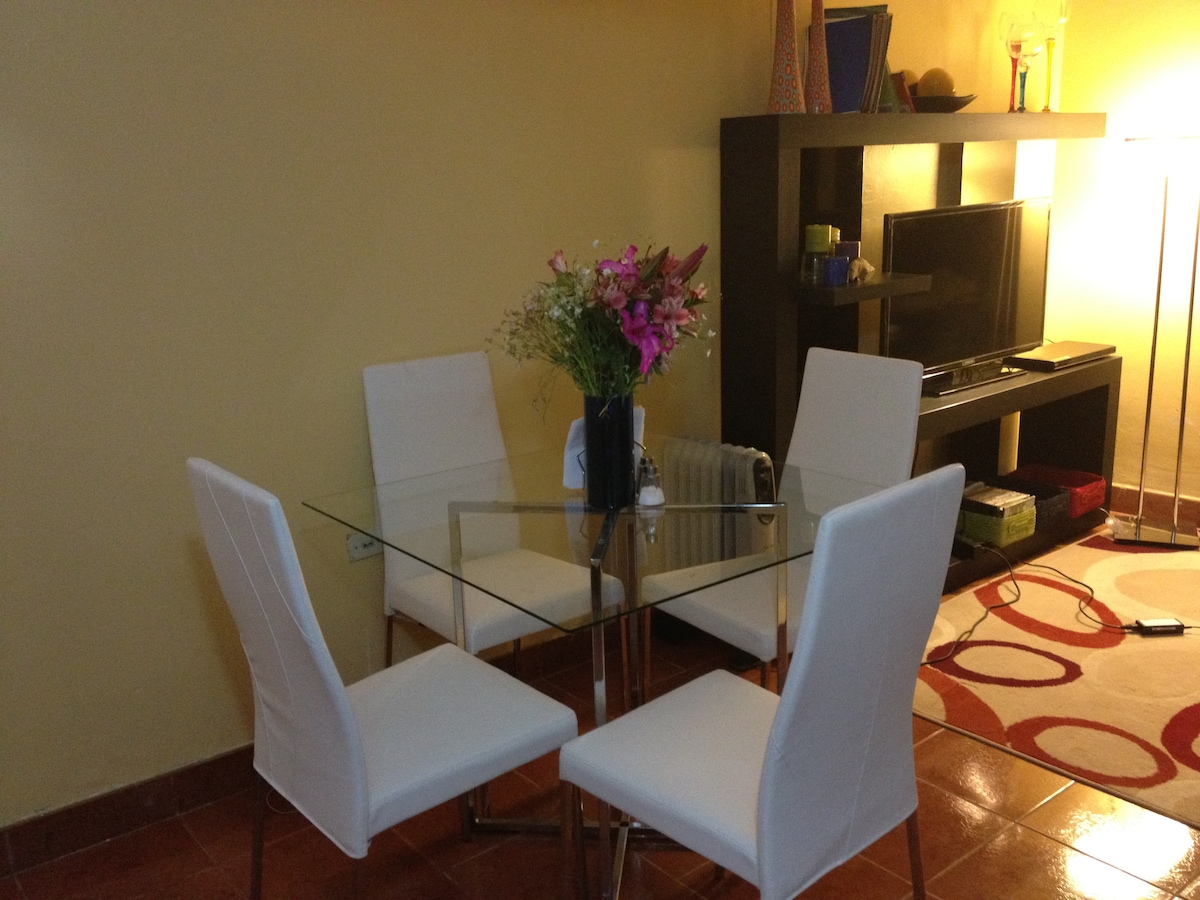 Eating area with white leather chairs