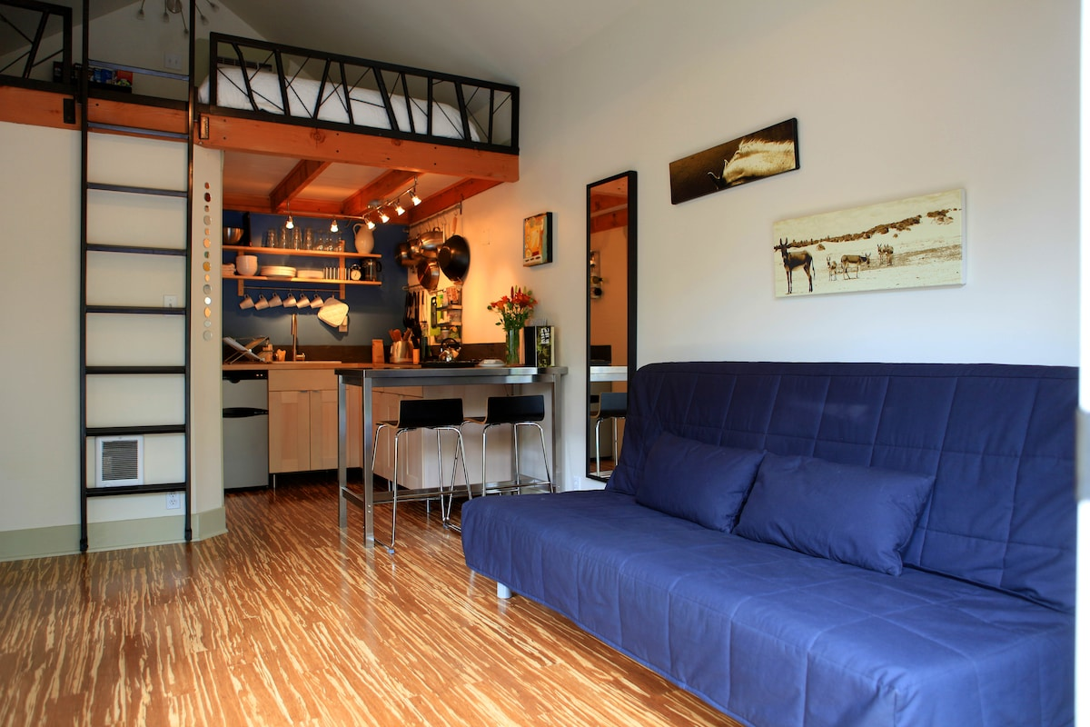view of the kitchen, sleeping loft & comfy fold out couch bed