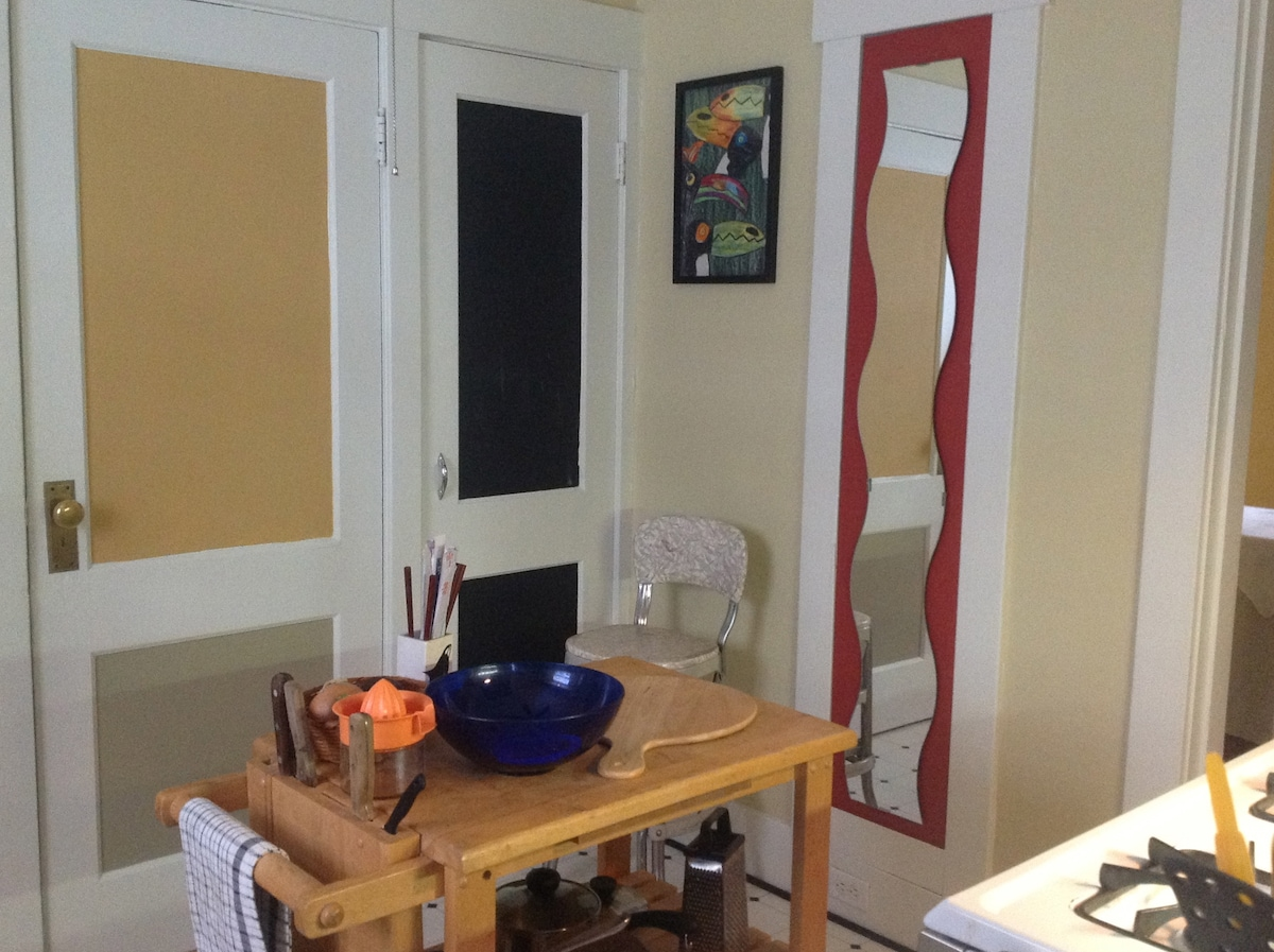 One corner of this super cute kitchen. The yellow door goes outside. The black one is the pantry.