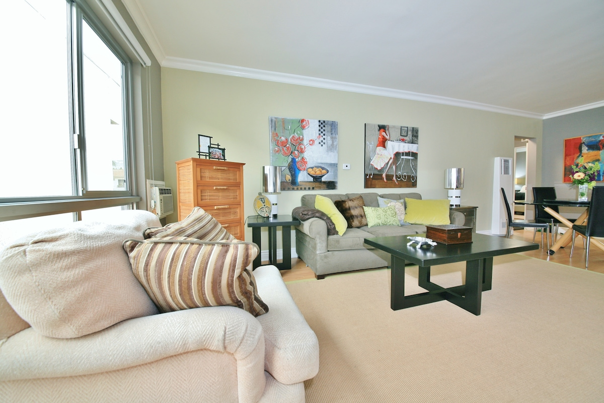 Great Room/Living Room of this Sunny and Roomy Two Bedroom, 2 bath unit with 2 masters