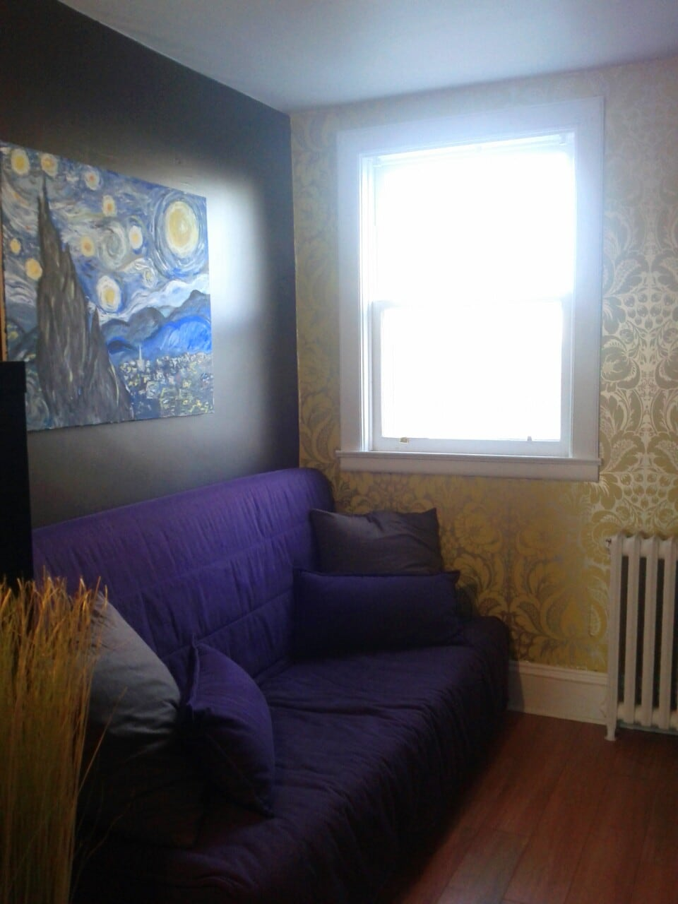 the guest room: bright, warm and a little van Gogh to keep you inspired - that purple futon folds out into glorious splendour