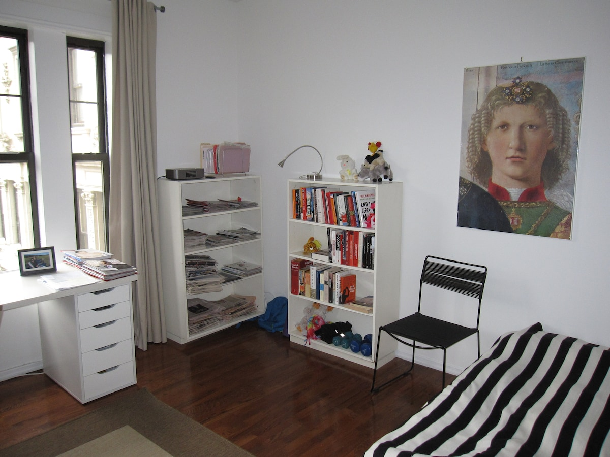 This is the bedroom and work area on the left with a view toward street