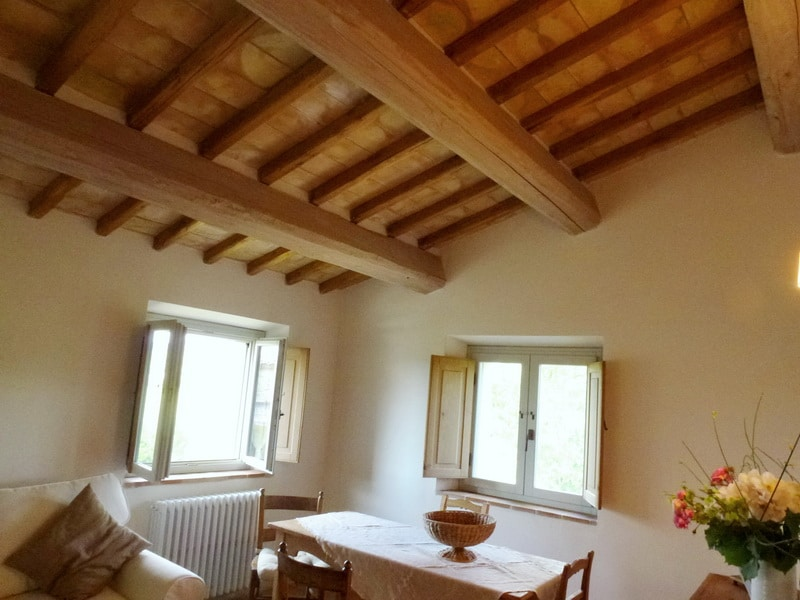 a traditional chestnut beam and terracotta tiles ceiling