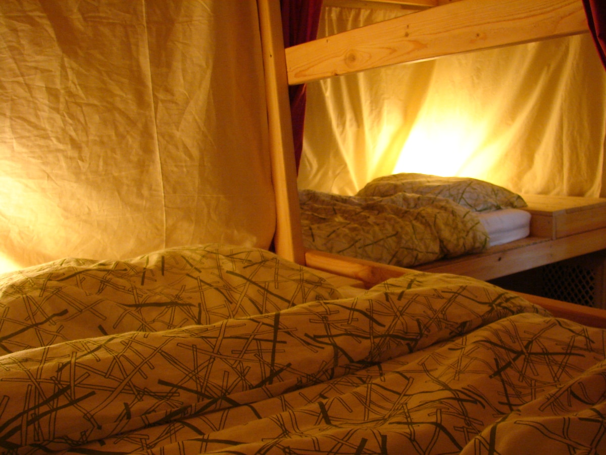 Individual lights and work spaces at each bunk