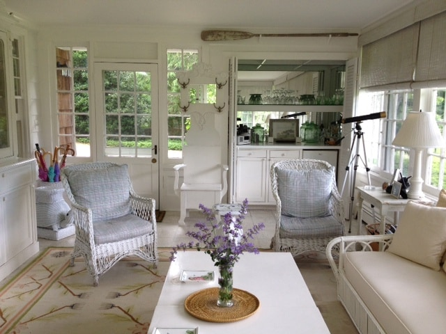 Sun room with surrounding large windows for plenty of (website hidden) with small fridge.