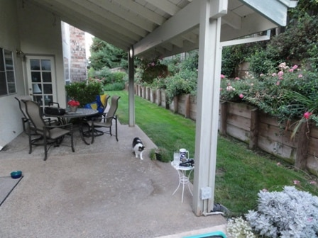 Covered patio with outdoor dining space.
