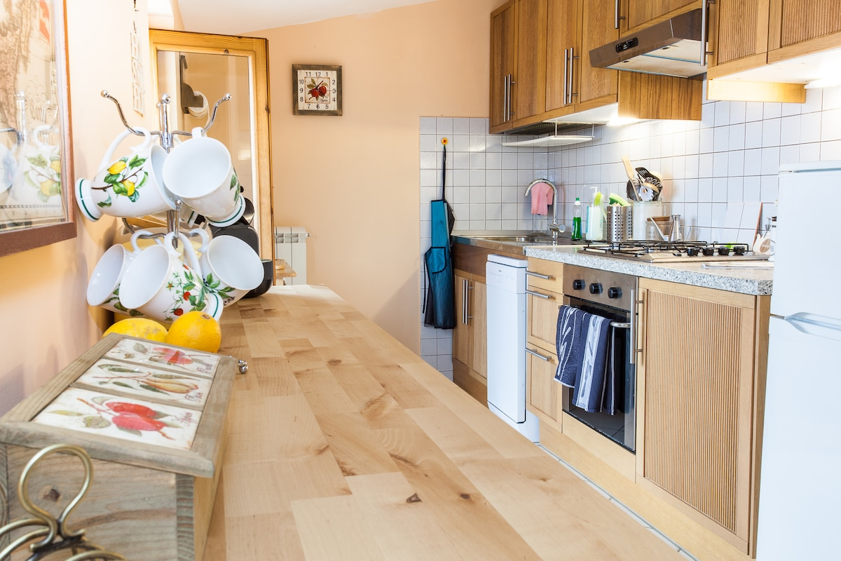 The kitchen is extremely well equipped and leads directly to  the outdoor dining area. area