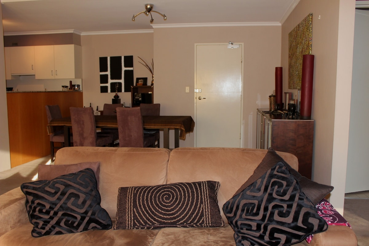Sofa with the kitchen and dining area behind