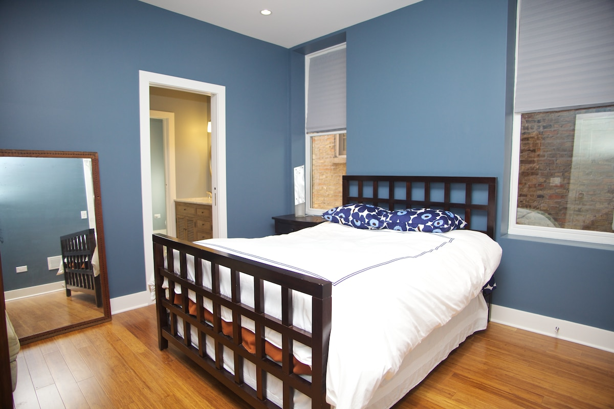 Queen-sized bed with ample room to move around.