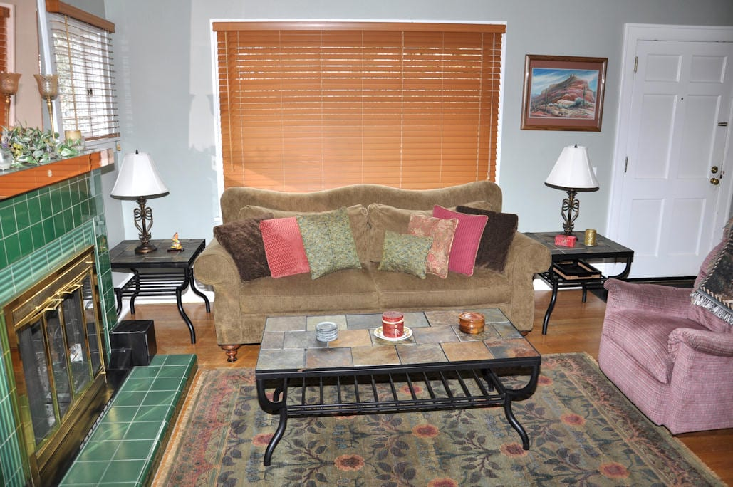 Relax on the Antique Camelback Sofa