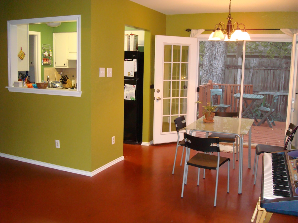 The dining area leads to the kitchen and laundry area in back.