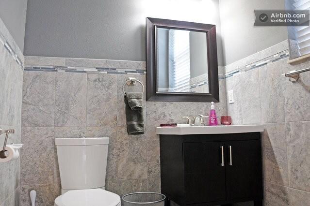 PRIVATE BATHROOM W/ WALK IN SHOWER & RAIN HEAD