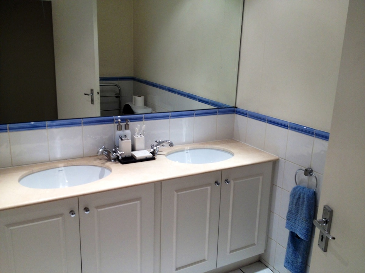 There are two sinks in the bathroom with plenty of space for toiletries and products!