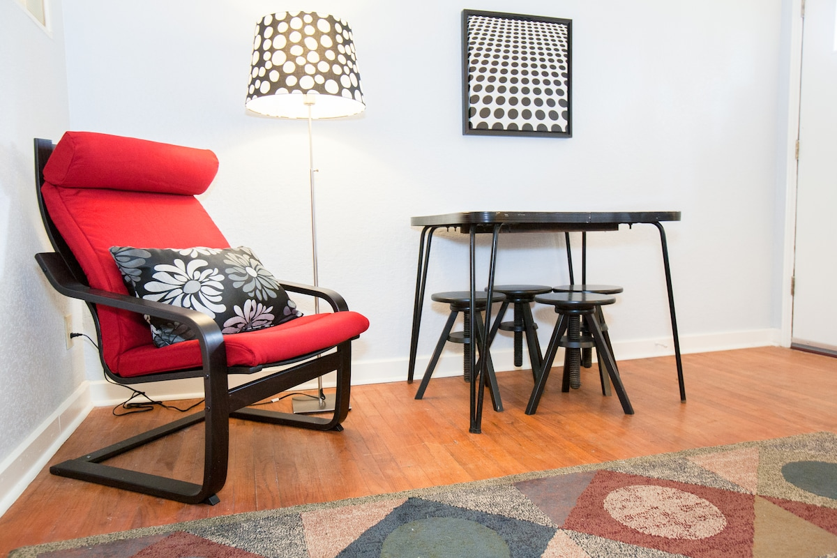 A comfortable chair provides the perfect corner for a quiet moment, or pull out the table for a spirited card game!