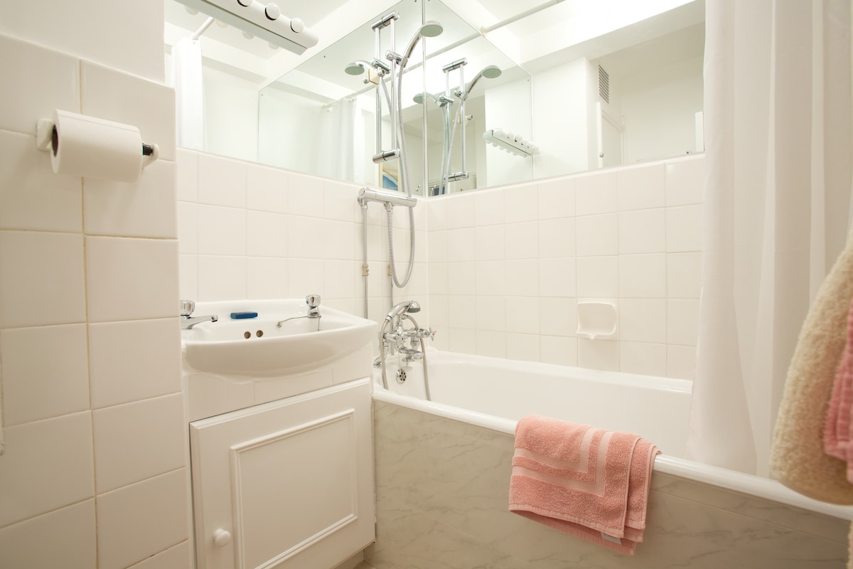 Redecorated bathroom with new power shower and thermostatic mixer