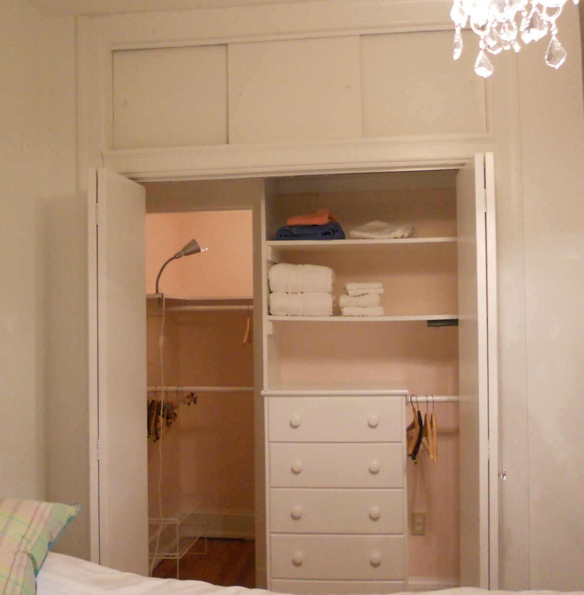 Large bedroom closet and crystal chandelier.