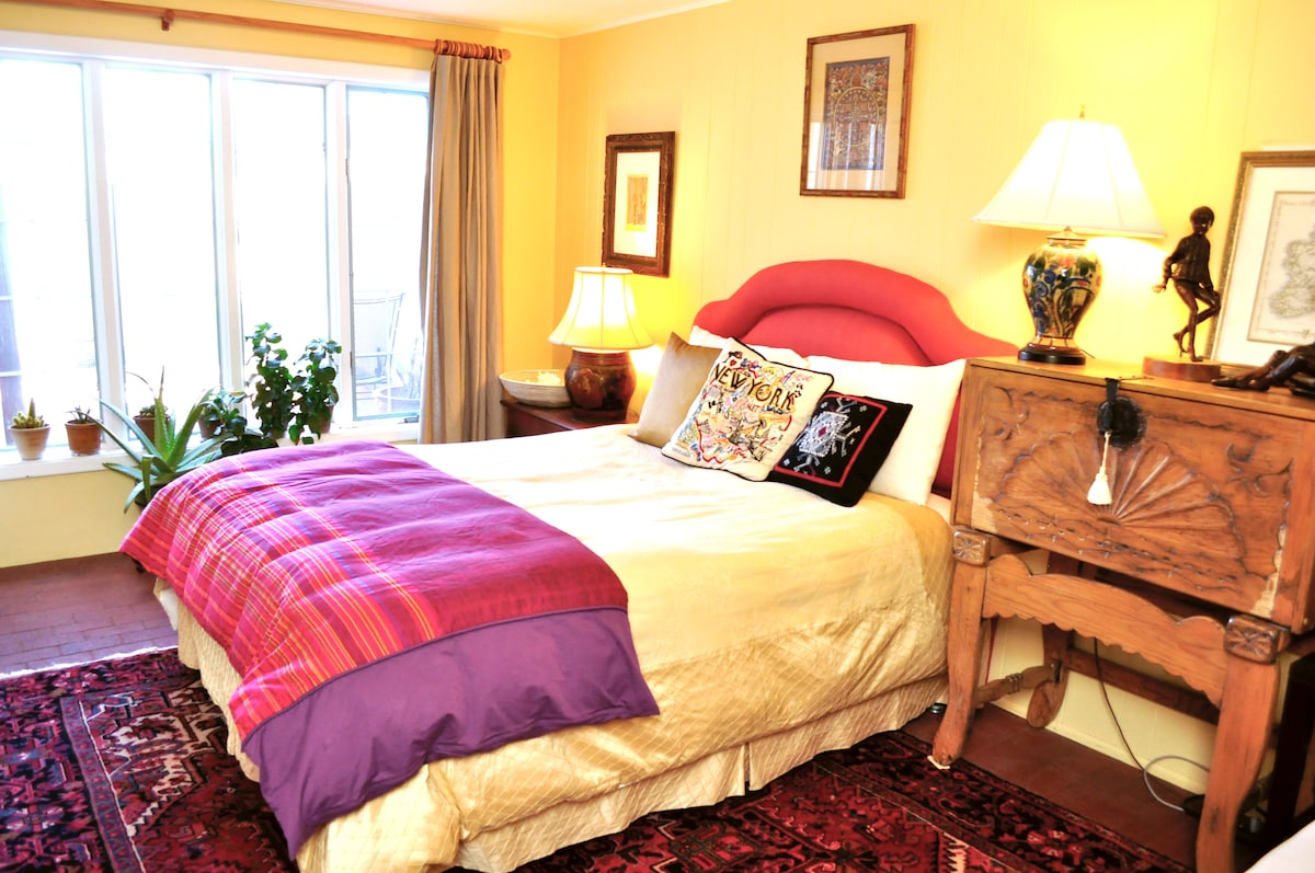 your bright comfortable bedroom has a queen size bed.