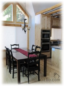 Dining Room with seating for 6 at the dining table and 3 at the breakfast bar