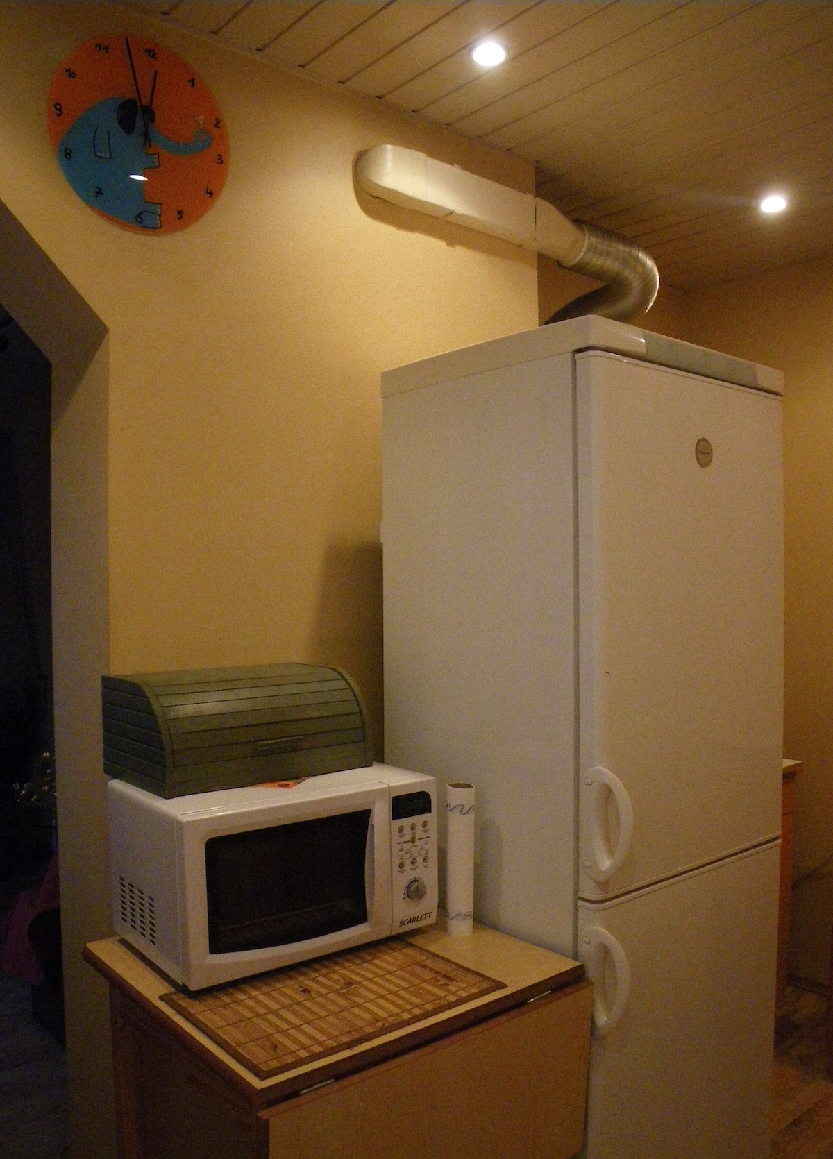 Small kitchen with microwave, refrigerator, gas ring, fully equiped with neccessary table plates,dishes, pots, pan, etc