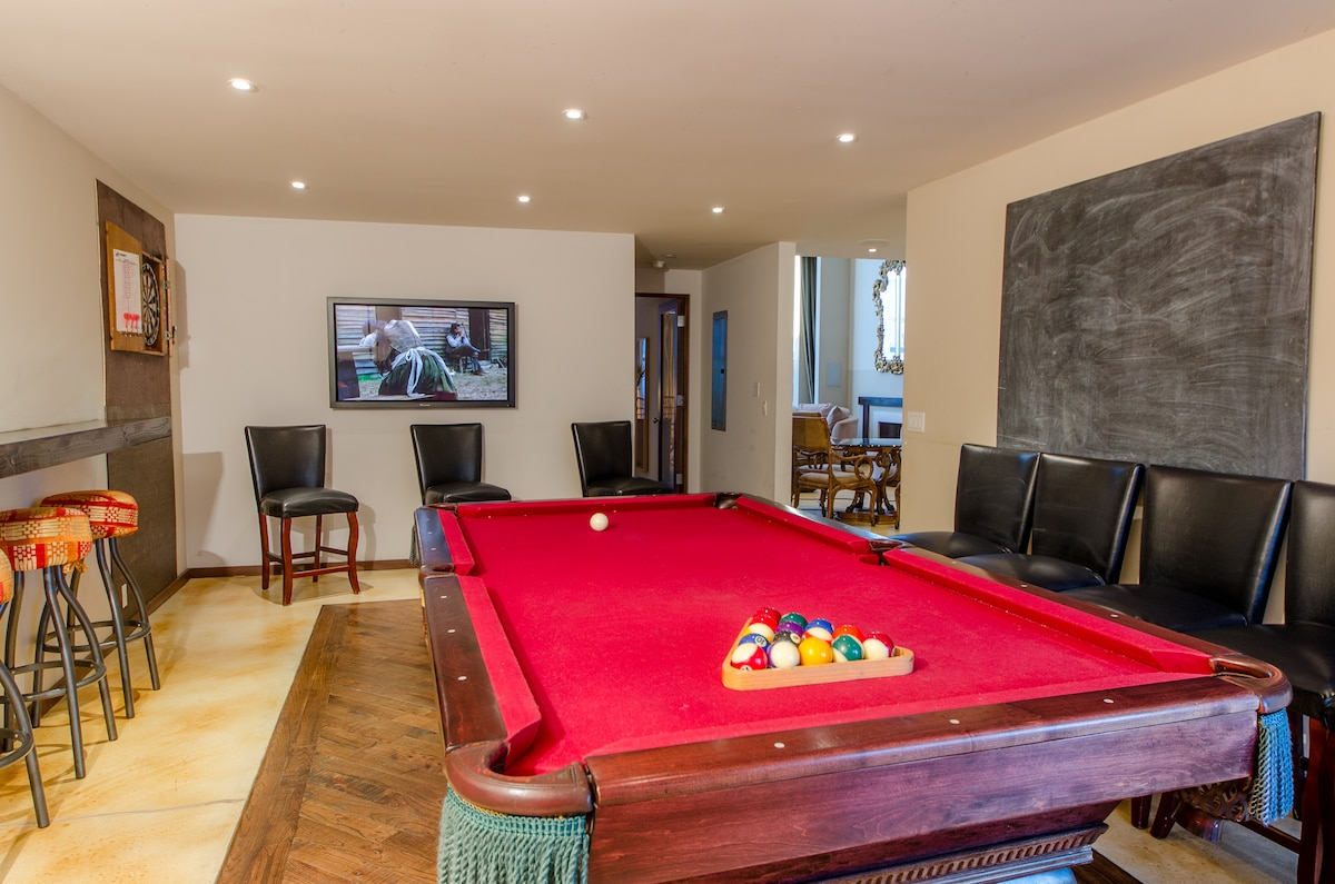 Flat screen on the back wall & giant chalk boards on the right in the Pool Room.