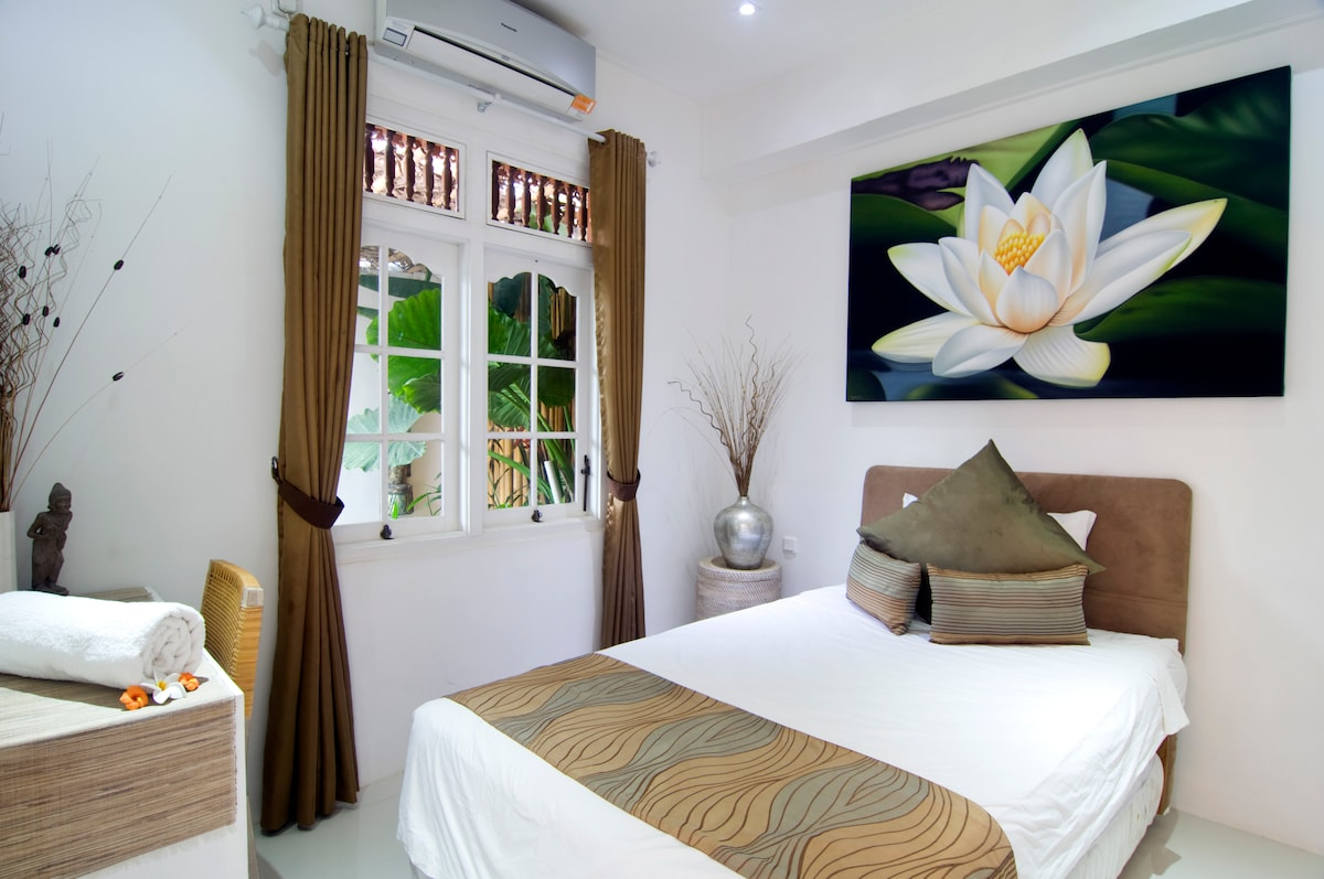 BED 3 The double room over looks the fish pond and across to the pool, AC and ceiling fan.  Separate bathroom.