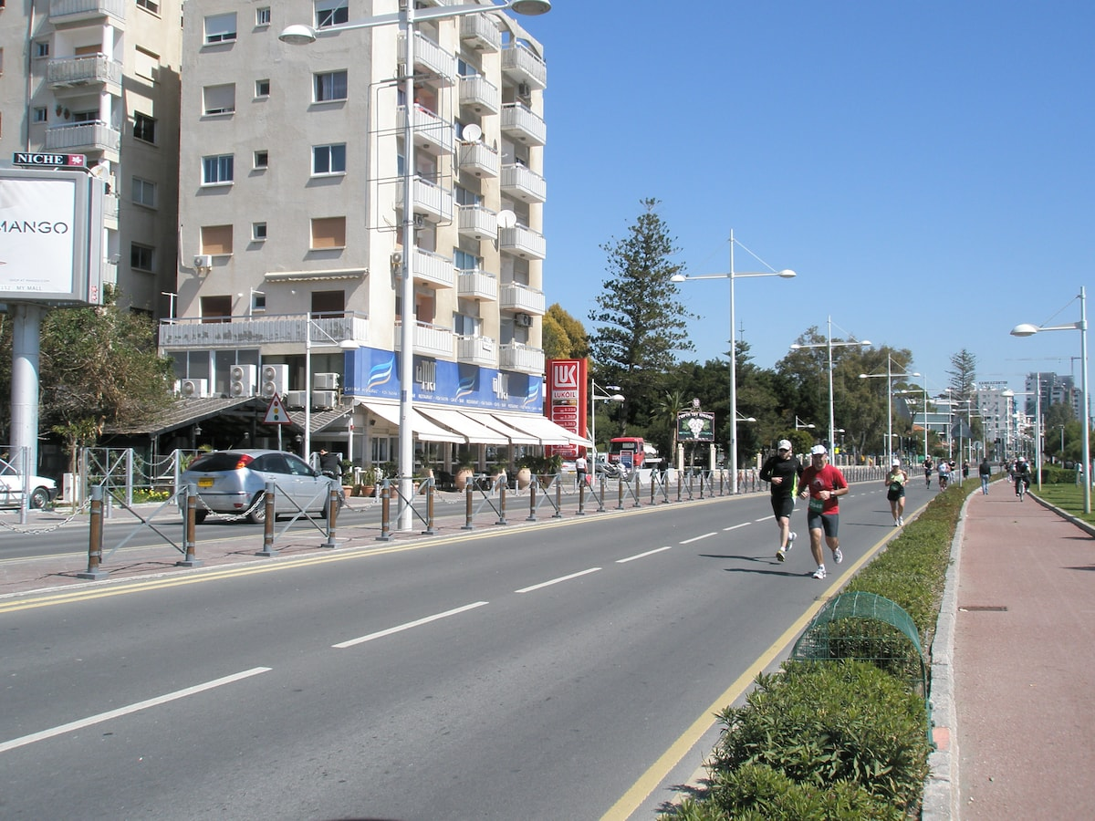 a view of the apartment building with the bicycle lane during a marathon