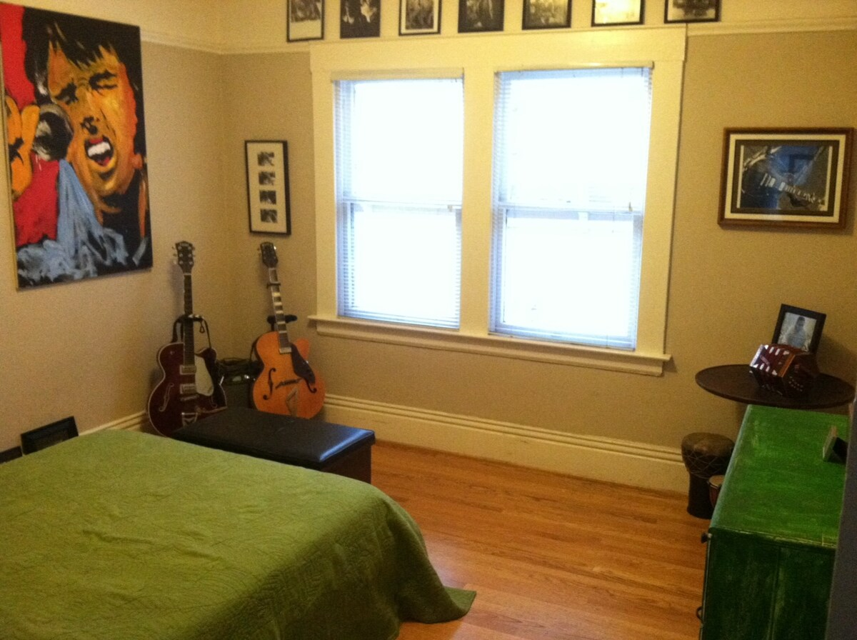 Another view of the guest room, which has a closet and dresser.