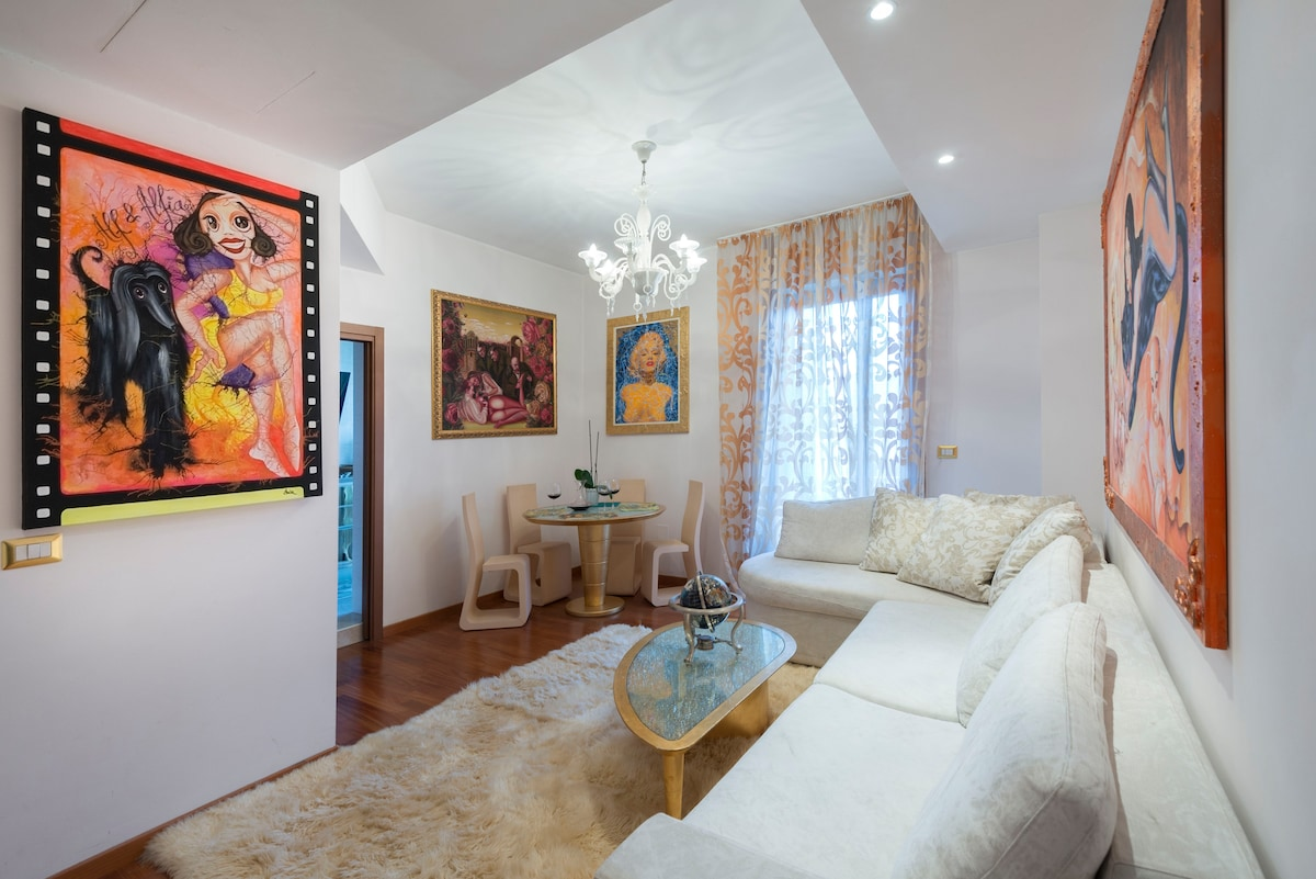 The white sofa converts into a double bed. The chandelier is actual Murano glass.