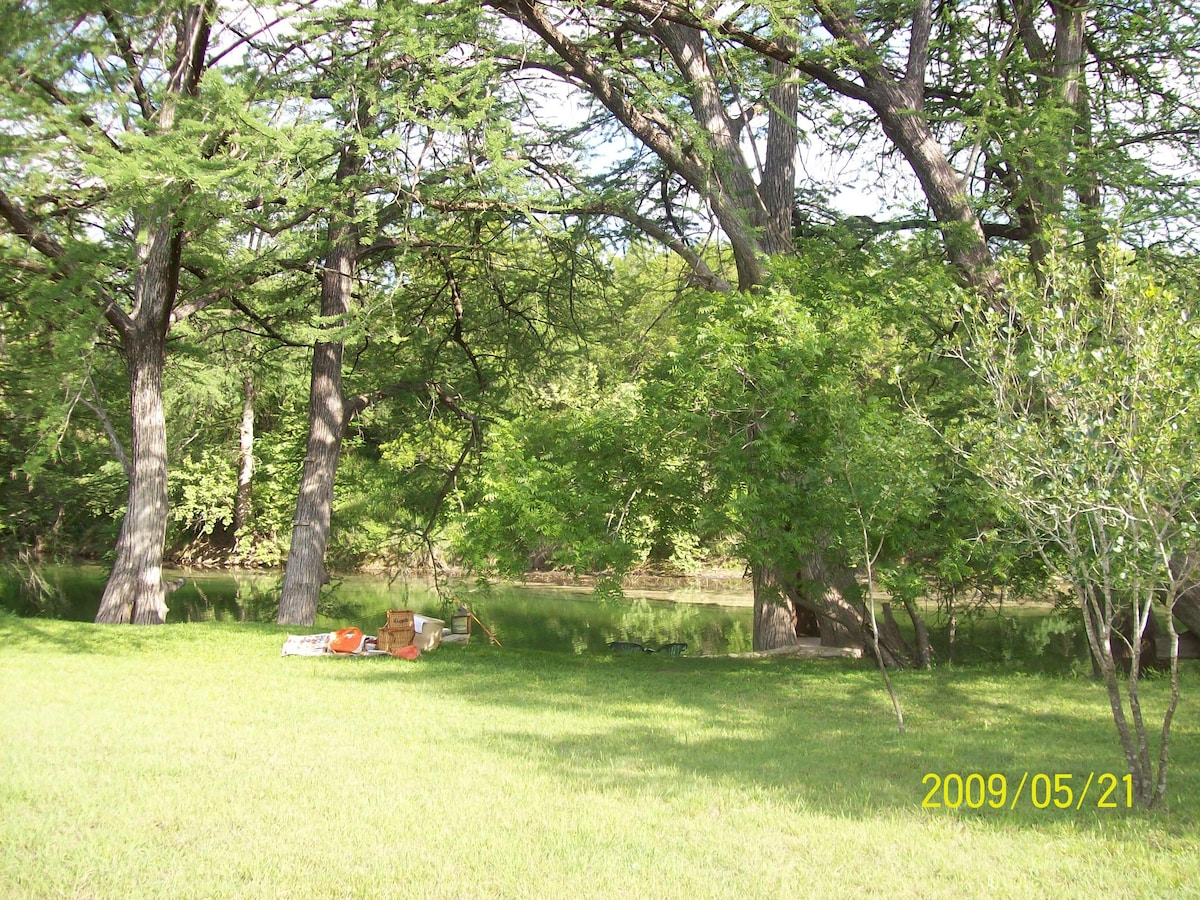 Enjoy a beautiful picnic area before taking a dip in the Blanco River.