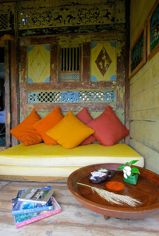 The wall behind the bed is hand carved by artisans