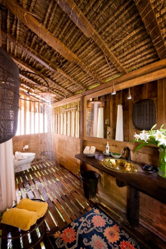 Bathroom with shower running. Note the wash basin is copper and hand hammered by Balinese artisans
