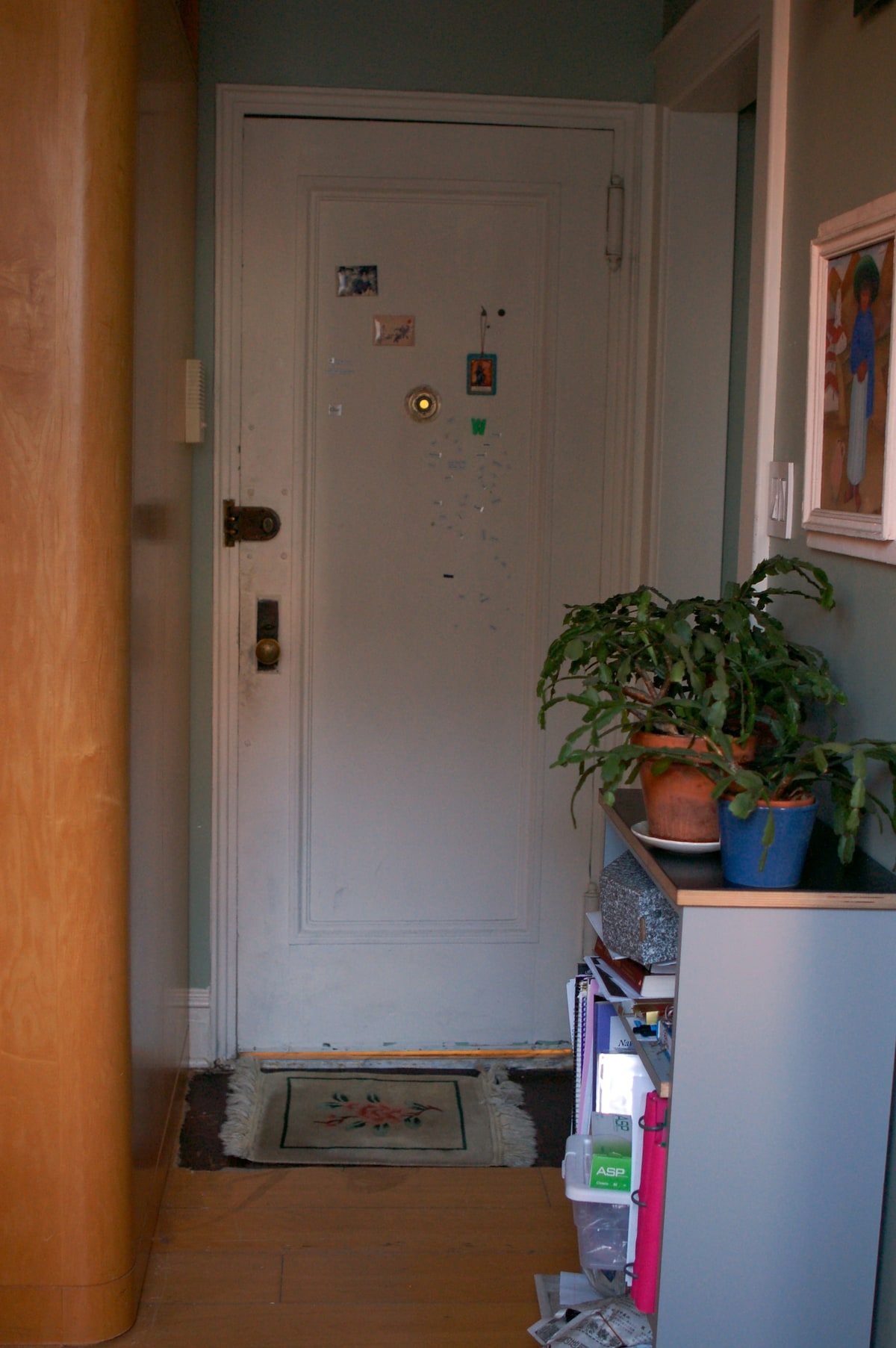 The private entrance/exit. To the right, hallway to main apartment and kitchen.