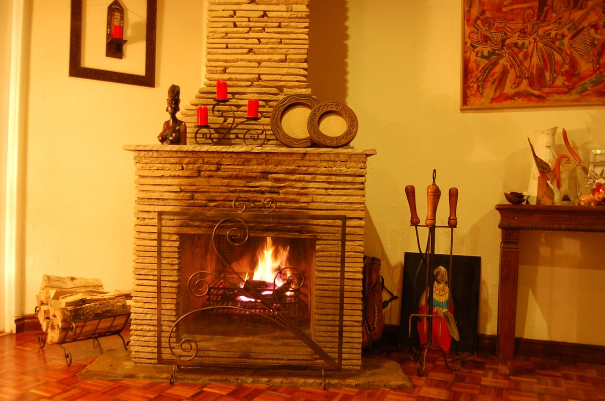 On cooler nights, come warm yourself by the fireplace. Karen experiences cooler nights due to its elevation and proximity to bushland.