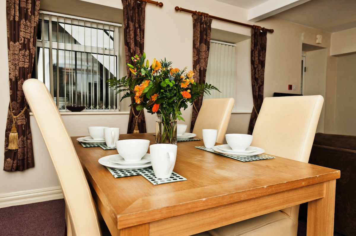 The large dining table is perfect for serving meals.